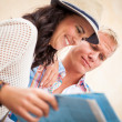 Stock Photo: Young attractive tourist couple with city map in summer