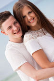 Attractive young couple in love having fun in summer holidays — Stock Photo