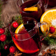 Hot tasty spicy mulled red wine with orange and cinnamon christmas — Stock Photo #35606173