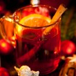 Hot tasty spicy mulled red wine with orange and cinnamon christmas — Stock Photo
