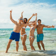 young happy friends havin fun on the beach — Stock Photo #35608453