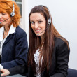 Friendly callcenter agent operator with headset telephone  — Stock Photo