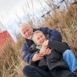 Happy mature couple relaxing baltic sea dunes — Stock Photo #35610171