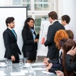 Business team in office meeting presentation conference — Stock Photo #35611355
