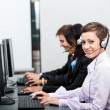 Smiling callcenter agent with headset support — Stock Photo