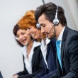 Friendly callcenter agent operator with headset telephone  — ストック写真