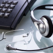 Working place office desk table headset glasses telephone — Stockfoto