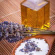 Lavender massage oil and bath salt aroma therapy wellness — Stock Photo #35613923
