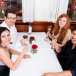 Smiling happy people in restaurant — Stock Photo