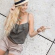 Happy young blonde woman with hat outdoor summertime — Stock Photo