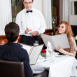 Man and woman for dinner in restaurant — Stock Photo