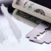 Cocaine lines on mirror with razor blade drugs objects — Stock Photo