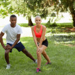 Young couple runner jogger in park outdoor summer — Stock Photo