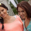 Two attractive young girls women on shopping tour — Foto de Stock