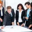 Business people discussing architecture plan sketch — Stock Photo #36601389