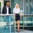 Young successful business man and woman outdoor — Stock Photo