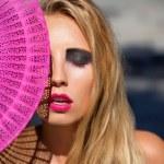 Постер, плакат: Young beautiful woman with smokey eyes and pink lips