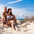 Affectionate young couple on the beach — Stock Photo