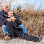 Happy mature couple relaxing baltic sea dunes — Stock Photo #36606829