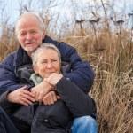Happy mature couple relaxing baltic sea dunes — Stock Photo #36606869