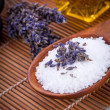 Lavender massage oil and bath salt aroma therapy wellness — Stock Photo #36607395