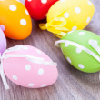 Colorful easter egg decoration on wooden background — Stock Photo