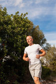 Athletic man runner jogging in nature outdoor — Stock Photo