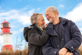 Happy mature couple relaxing baltic sea dunes — Stock Photo