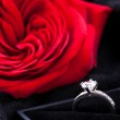 Red rose and diamond ring in a box — Stock Photo #37445201