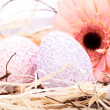Beautiful Easter eggs in crocheted covers — Stock Photo #37457403