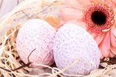 Beautiful Easter eggs in crocheted covers — Stock Photo