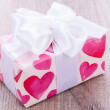 Stock Photo: Pretty Valentines gift with hearts on giftwrap