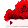 Valentines gift of beautiful red roses — Stock Photo #37936159