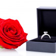 Engagement ring with a bunch of red roses — Stockfoto #37936163
