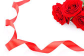 Bouquet of red roses with ribbon border — Stock Photo
