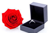 Engagement ring with a bunch of red roses — Stock Photo