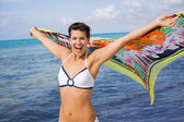 Laughing vivacious woman at the seaside — Stock Photo