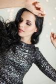 Beautiful dreamy woman with glitter dress dancing — Stock Photo