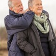 Happy senior couple elderly people together outdoor — Stock Photo #37989419
