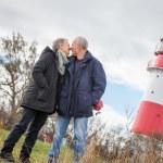 Happy mature couple relaxing baltic sea dunes — Stock Photo