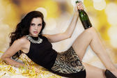 Beautiful young woman partying with champagne — Stock Photo