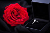 Red rose and diamond ring in a box — Stock Photo