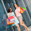 Attractive young girls women on shopping tour — Stock Photo #37992141