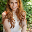 Beautiful smiling young redhead woman portrait outdoor — Stock Photo #37992451