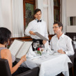 Stock Photo: Young smiling couple at restaurant