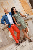 Young attractive couple in summer fashion — Стоковое фото