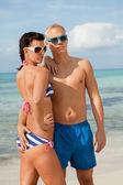 Sexy trendy couple posing in swimwear at the sea — Foto de Stock
