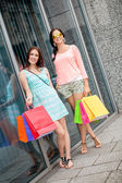 Attractive young girls women on shopping tour — Foto Stock