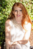 Beautiful smiling young redhead woman portrait outdoor — Stock Photo