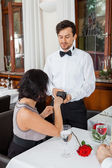 Dinner in restaurant man and woman pay by credit card — Stock Photo